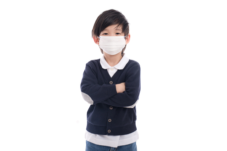 Asian child with protection mask on white background isolated
