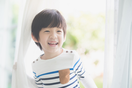 blind child: Portrait of cute Asian child at the open window