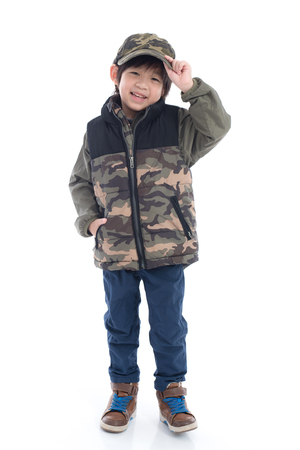 Happy asian child in  Camouflage winter clothes standing on white background isolated