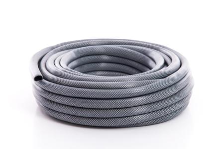 curled garden hose isolated on white background Stock Photo