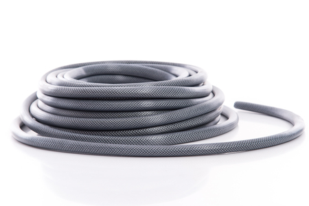 curled garden hose isolated on white background Stok Fotoğraf