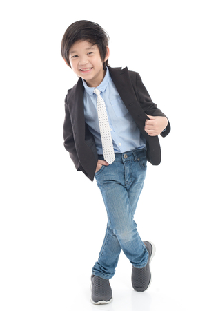 Asian smiling child boy in business suit on white background isolated