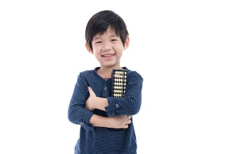 Cute Asian child holding Soroban abacus on white background isolated Stockfoto