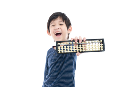 Cute Asian child holding Soroban abacus on white background isolated Stock Photo