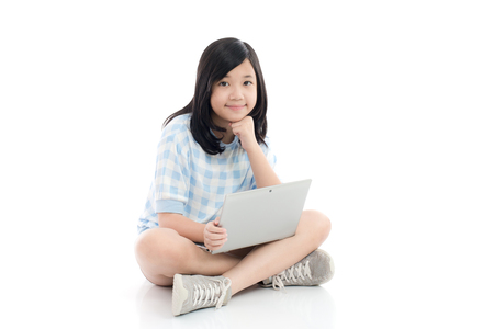 Happy Asian girl with laptop, isolated on white background Фото со стока