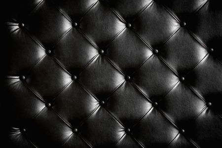 close up of Luxurious black leather texture furniture with buttons Stock Photo