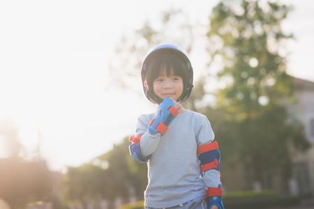 Close up of Cute Asian boy in blue helmet