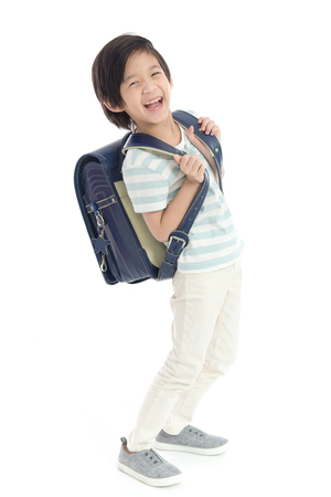 Portrait of Asian schoolboy with backpack  isolated on white