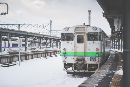 Local train on a snowy train station in winter