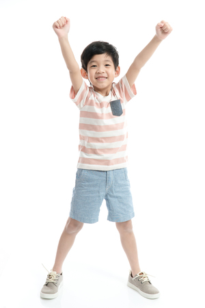Cute Asian child showing winner sign on white background isolated Archivio Fotografico - 109006115