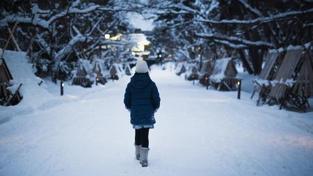 Asian girl walking in the park in the winter  night,Aomori Japan