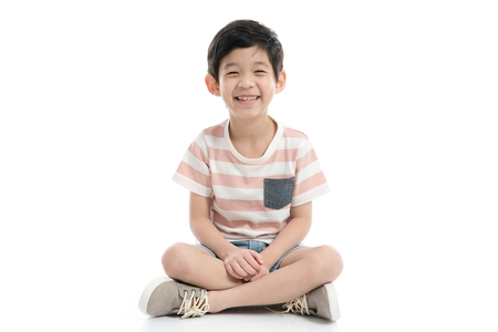 Cute Asian child sitting on white background isolated Stock Photo - 108818831