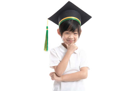 Happy Asian child in graduation gowns on white background isolated.Graduation concept