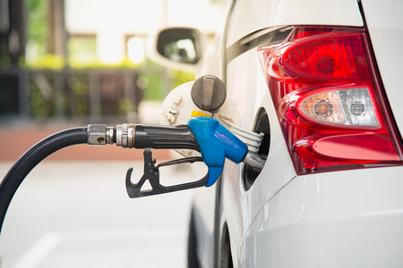 Refill fuel to a car at oil station