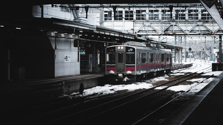 Akita,Japan, 31 January  2018:Local train on a snowy train station in winter