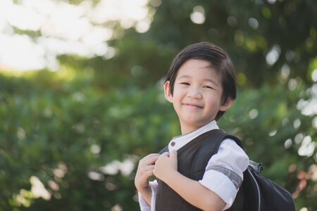 Portrait of Asian student with backpack outdoors, back to school concept Imagens