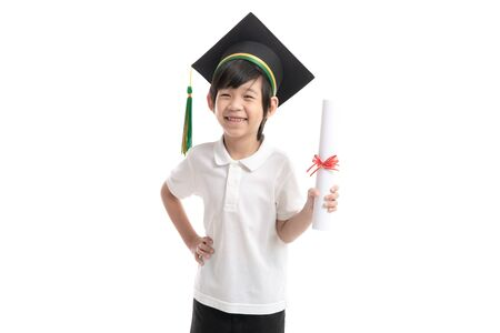 Happy Asian child in graduation gowns holding a Certificate on white background isolated. Graduation concept