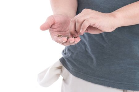 Coins in hand with empty pocket on white background isolated Stock Photo