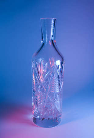 decanter: decanter on blue-red background