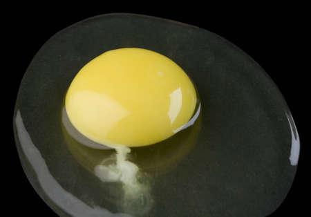 broken egg isolated on black