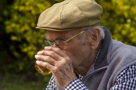 narrow depth of field: Old Man With a Grey Beard drinking a glass of wine, selected focus, narrow depth of field