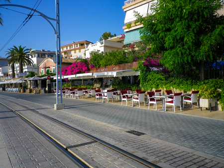 he is a traditional: PORT DE SOLLER, SPAIN, June 30, 2015: Tramway connecting town to Soller opened in 1913 and is about 5 km long. Some its original, 1913-built cars are still in service on the line. Pictured onJune 30, 2015