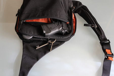concealed: A womans purse and gun and accessories