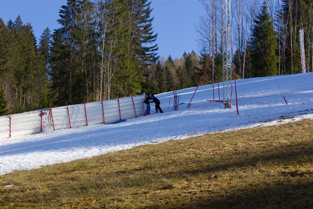 winter escape: HINTERSTODER,  AUSTRIA - February 22, 2016: Countdown, The Austrian team is working at full speed to complete the world cup slope and the finish area for competitions on 26 to 28 February 2016 Hinterstoder. Editorial