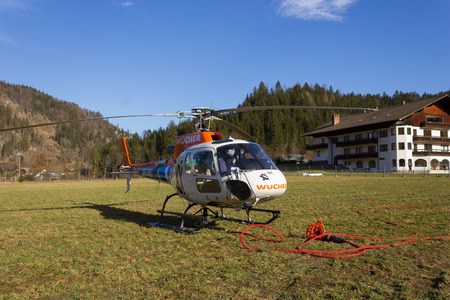 timekeeping: HINTERSTODER,  AUSTRIA - February 22, 2016: this helicopter transported heavy equipment up to the mountain, to complete the world cup piste and the finish area for competitions on 26 to 28 February 2016 hinterstoder.