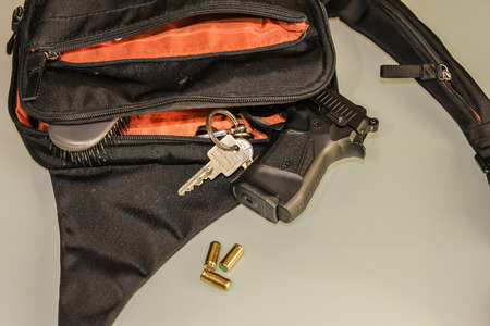concealed: Carried concealed. Handgun and accessories falling from a womans purse.