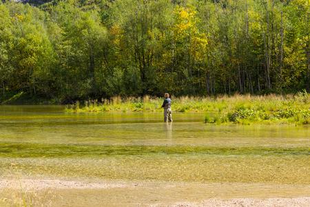 springwater: alpine mountain Lake, Fishing men