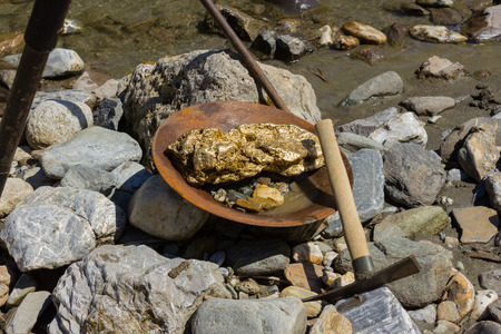 nugget: Gold Nugget mining from the River, with a gold pan, and find some big gold nugget.