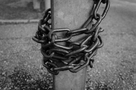 rusty chain: Close-up view of old rusty chain links.