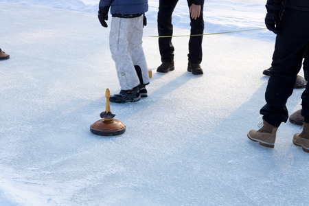People playing curling on a frozen lake, Austria, Europe. winter sport.