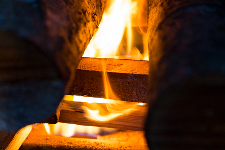 smolder: fire and wood burning in a fireplace. Close-up image, Fire and Flame in the stove