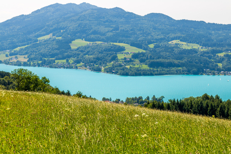 beautiful clear alpine lake Attersee with green water, salzkammergut, Austria, europe Stock Photo