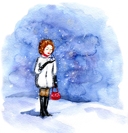 The  girl looks at falling snow