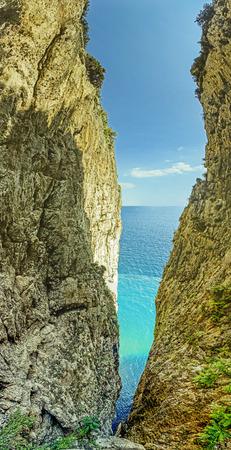 a crack in the rock between sky and sea. Gaeta