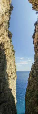 slit: Gaeta split mountain: a slit between sea and sky Stock Photo