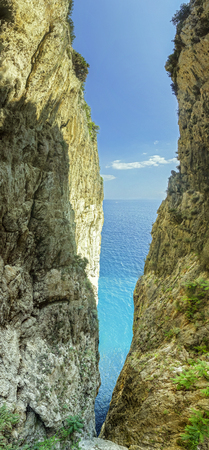 enchantment: Gaeta split mountain: a slit between sky and sea