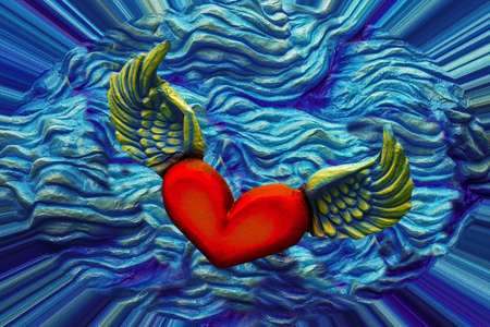 papiermache: the heart has wings and flies in the blue painted blue Stock Photo