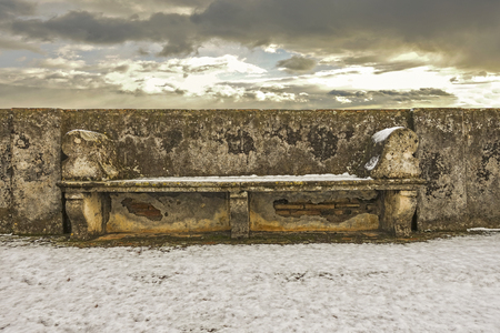 Stone seat on the terrace among the snow - 113