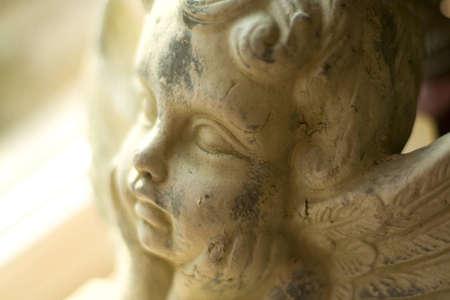 Angel stone statue holding his head photo