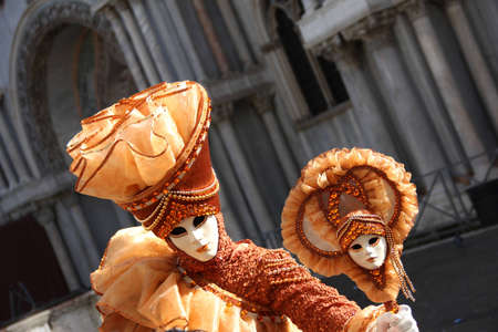 carnevale: A beautiful orange mask during Venice Carnevale Stock Photo