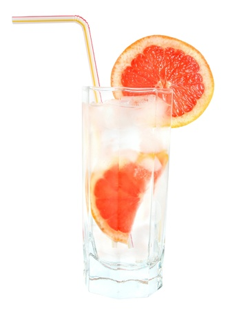 A glass of ice water and grapefruit. Stock Photo