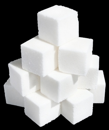 Pieces of sugar on a black background.