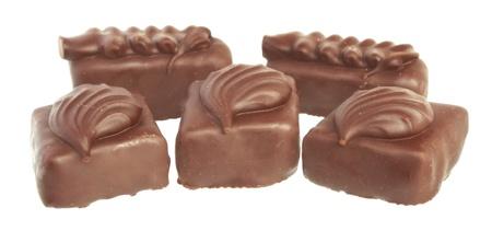 sweetmeats: The Chocolate sweetmeats on white background. Stock Photo
