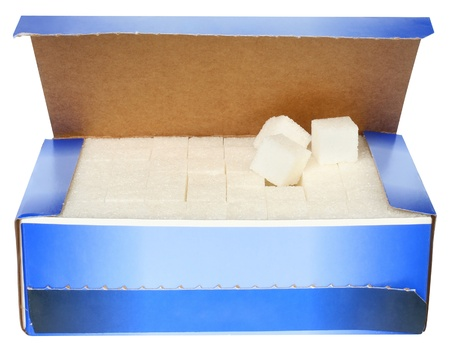 lump: Lump sugar in a box on a white background. Stock Photo
