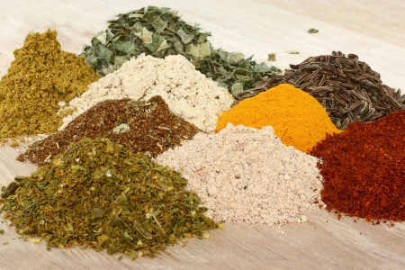 savour: A set of spices on wooden cutting board. Stock Photo