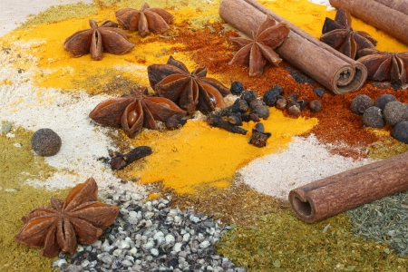 A set of spices on wooden cutting board. Stock Photo - 14458996